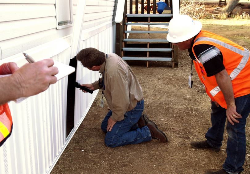 home inspector at a trailer home